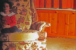 Mary on threadbare chair